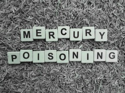 Mercury Poisoning, word cube with background.
