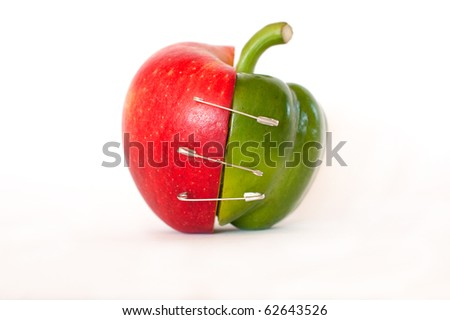 Merge of apple and pepper - isolated on white