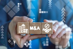 Merger and Acquisition Business Corporate Cooperation Company concept. MA partnership concept on wooden dices in businessman's hands.