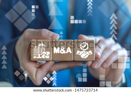 Merger and Acquisition Business Corporate Cooperation Company concept. MA partnership concept on wooden dices in businessman's hands. Photo stock ©