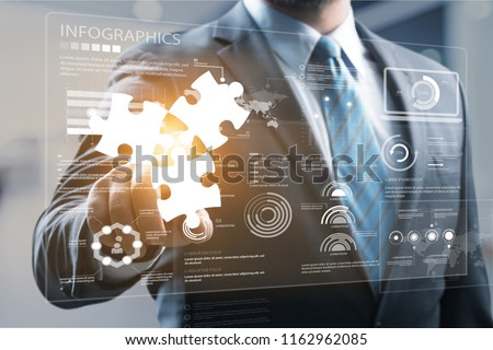 Mergers and acquisition concept with consultant touching icons of puzzle pieces representing the merging of two companies or joint venture, partnership #1162962085