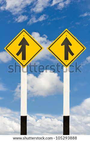 Merging lane from left and right road signpost on cloudy sky background
