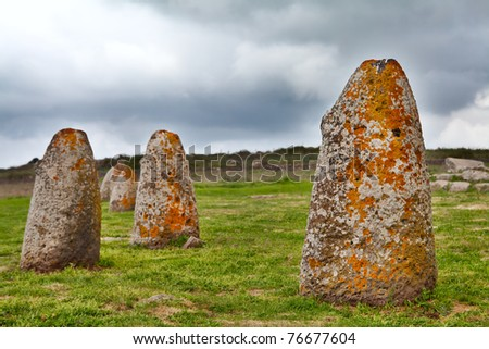 Merhir megalith stone in Sardinia Sardegna Italy big megalith stone standing in field archeological monument history - stock photo