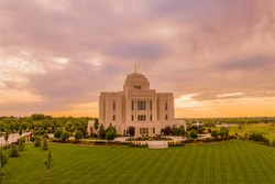 Meridian Idaho Temple lit by a dramatic sunset