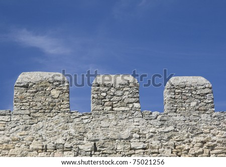 Merlons of an old fortress wall in a sunny day
