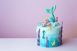 Mermaid birthday cake on a purple background