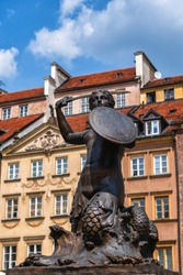 Mermaid of Warsaw called Syrenka in Warsaw, Poland, city symbol in the Old Town, bronze statue designed by Konstanty Hegel in 1855.