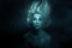 Mermaid.Toned photo of face under water