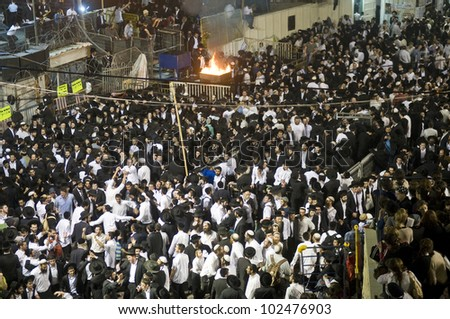 MERON , ISRAEL - MAY 10 : unidentified Orthodox Jews celebrates Lag Ba'omer in Bar Yochai tomb in Meron , Israel on May 10 2012 , Lag Ba'omer is a Jewish holiday in wich it is customary to light bonfire