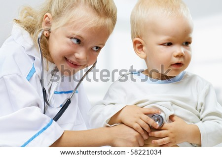 merry children playing as doctor and patient