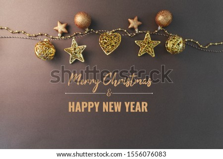 Merry Chrismas and Happy New Year, gold chrismas ball hanging on the background