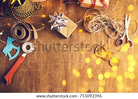 Merry Christmas and Happy Holidays! Christmas preparation, scissors, ribbons, stationery knife, sellotape #755092396