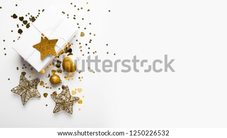 Merry Christmas and Happy Holidays greeting card, frame, banner. New Year. Christmas golden gifts, presents on white background top view. Winter holiday xmas theme. Noel. Flat lay. #1250226532
