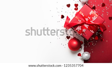 Merry Christmas and Happy Holidays greeting card, frame, banner. New Year. Christmas red gifts, presents on white background top view. Winter holiday xmas theme. Noel. Flat lay. #1235357704