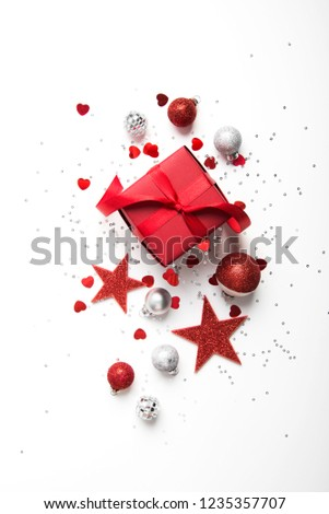 Merry Christmas and Happy Holidays greeting card, frame, banner. New Year. Christmas red gifts, presents on white background top view. Winter holiday xmas theme. Noel. Flat lay. #1235357707
