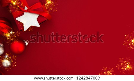 Merry Christmas and Happy Holidays greeting card, frame, banner. New Year. Christmas red gifts, presents and ornaments on red background top view. Winter holiday xmas theme. Flat lay. #1242847009