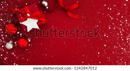 Merry Christmas and Happy Holidays greeting card, frame, banner. New Year. Christmas red gifts, presents and ornaments on red background top view. Winter holiday xmas theme. Flat lay. #1242847012