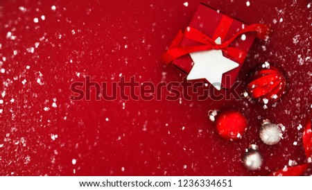 Merry Christmas and Happy Holidays greeting card, frame, banner. New Year. Christmas red handmade gifts, presents on red background top view. Winter holiday theme. Flat lay. #1236334651