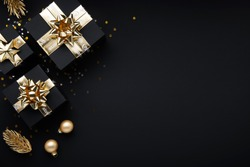 Merry Christmas and Happy Holidays greeting card, frame, banner. New Year. Noel. Gold Christmas gifts, ornaments on black background top view. Winter holiday xmas theme. Flat lay.