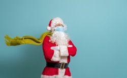 Merry Christmas and Happy Holidays! Santa Claus in face mask on bright color background. Covid-2019