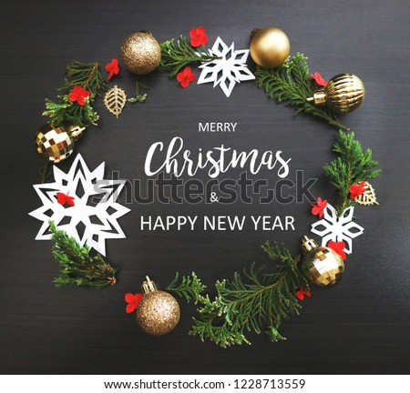 Merry Christmas and Happy New Year background. Xmas Ornaments and text on dark wood. #1228713559