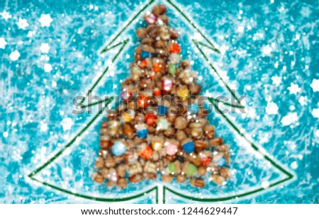 merry christmas and happy new year CARD background handmade handicraft garland of colored acorns - blurred picture