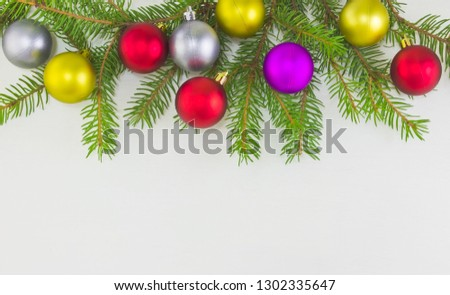 Merry Christmas and Happy New Year card with colorful balls and fir-tree  on white background. #1302335647