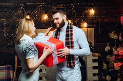 Merry christmas and happy new year. Christmas gifts. Man handsome with gift box surprise for girlfriend. Man hipster give gift to girl christmas decorations background. Surprise for sweetheart.