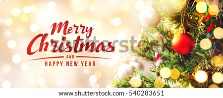 Merry Christmas and happy new year concept, Closeup of white bauble hanging from a decorated tree with bokeh, Xmas holiday background. #540283651