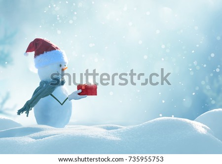 Stock Photo Merry christmas and happy new year greeting card . Happy snowman  standing in winter christmas landscape.