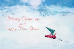 Merry Christmas and happy New Year greeting card. red toy car with christmas tree on snowy background. winter festive season
