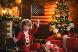 Merry Christmas and happy New Year in United States Of America. Santa helper with american flag. Christmas tree and american flag background