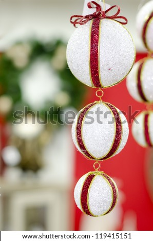 Merry Christmas and Happy new year, New Year's white ball with red ribbon on a red background abstract background lights