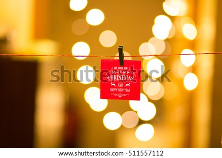 Merry Christmas and Happy New Year on bokeh background, festive defocused lights.  #511557112