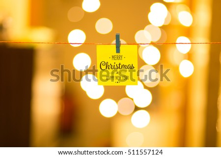 Merry Christmas and Happy New Year on bokeh background, festive defocused lights.  #511557124