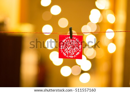 Merry Christmas and Happy New Year on bokeh background, festive defocused lights.  #511557160