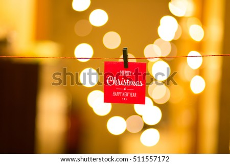 Merry Christmas and Happy New Year on bokeh background, festive defocused lights.  #511557172