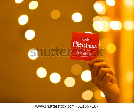 Merry Christmas and Happy New Year on bokeh background, festive defocused lights.  #511557187