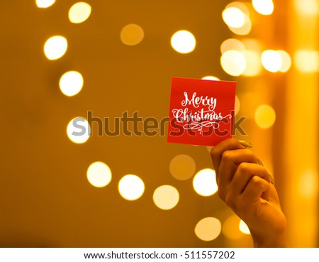 Merry Christmas and Happy New Year on bokeh background, festive defocused lights.  #511557202