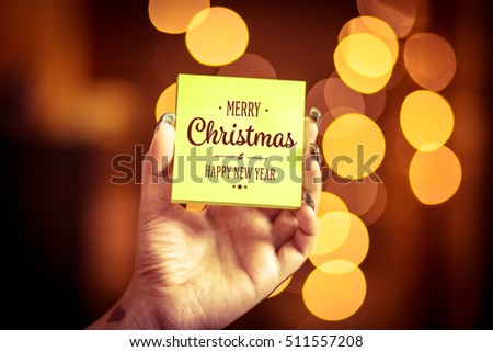 Merry Christmas and Happy New Year on bokeh background, festive defocused lights.  #511557208