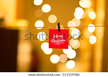 Merry Christmas and Happy New Year on bokeh background, festive defocused lights. #511559386