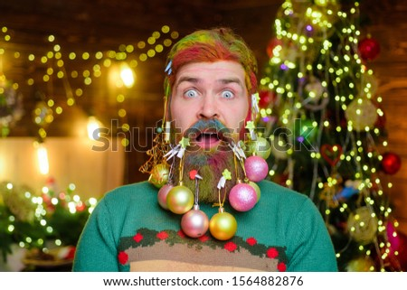 Merry Christmas and happy new year. Surprised bearded man with decorated beard. Christmas beard decorations. New year party. Bearded man with decorated beard. Christmas decorations. Decorated beard.