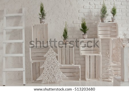 Merry christmas and new year brick wall background. white decor with fir trees and boxes. Loft style