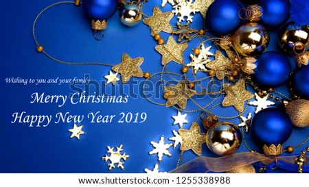 Merry Christmas and New Year greeting with ornaments stars  snowflakes and blue background