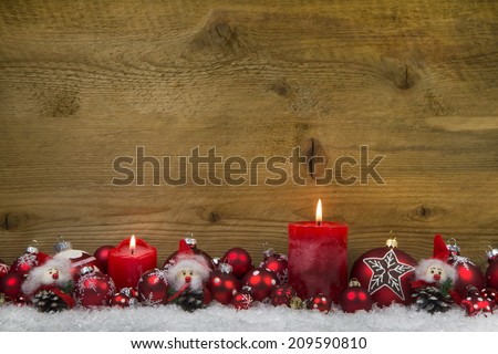 Merry christmas: Classic christmas decoration in red and white with two burning candles on wooden background. #209590810