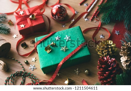 Merry christmas concepts with decorate gift box present and ornament element on wood table background.winter season's greetingactivity ideas.top view #1211504611