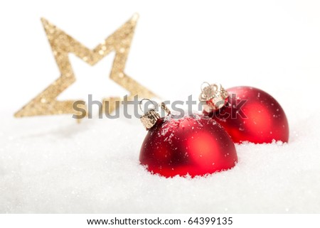 Merry Christmas everybody - Christmas baubles and a Star in a snow landscape