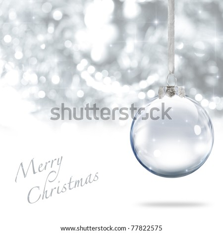 Merry Christmas glass ball against silver background