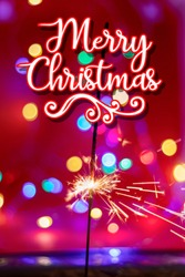 Merry christmas.Glittering burning sparkler on red and color bukeh  background
