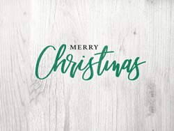Merry Christmas Green Graphic Calligraphy Text Design With White Wood Background